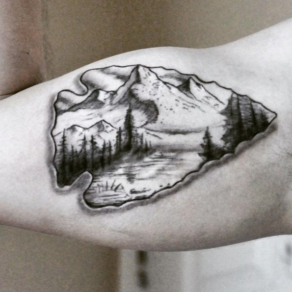 blackwork-arrowhead-tattoos