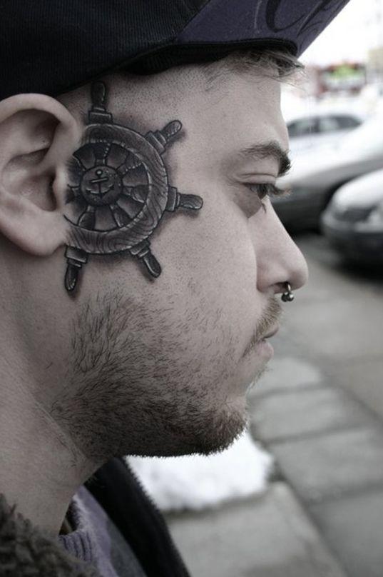 a-ships-wheel-face-tattoo1